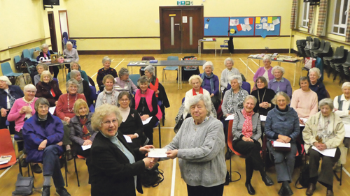 Guild hands over cash to dementia charity