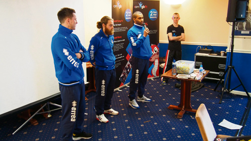 Bristol Rovers players Ollie Clarke, Stuart Sinclair and Jermaine Easter speaking to children at day two of the Brilliant Bristol project.